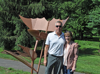 Artist Michael Clay and Mayor Kelly Burk in front of his sculpture