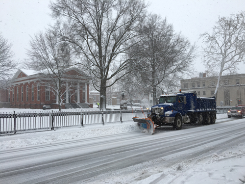 Snow plow on N King St in front of Loudoun County courthouse