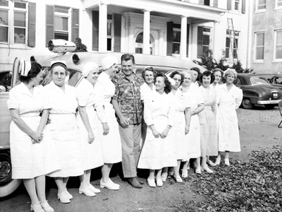 Arthur Godfrey and Loudoun Hospital nurses with new ambulance, 1952